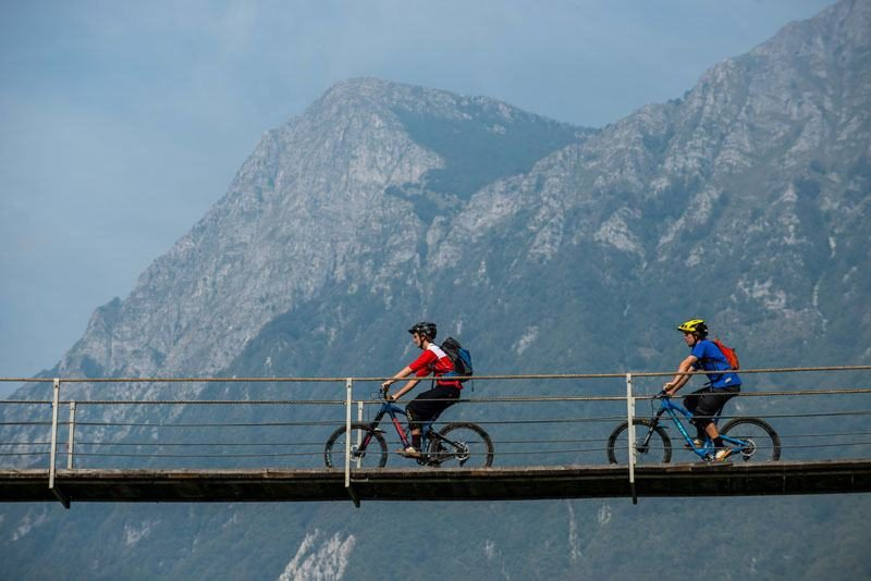 Best of Slovenia Single Trails bikers on bridge in soca valley