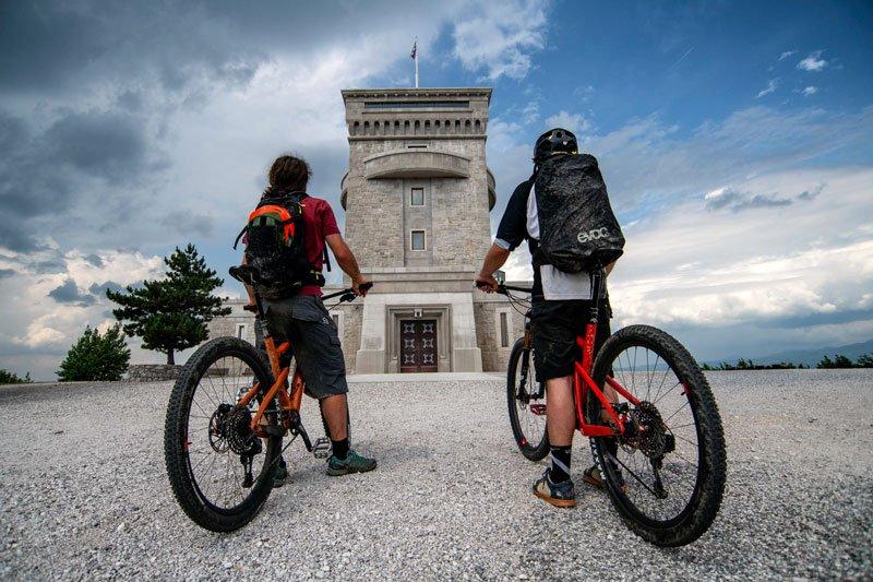 Trans Slovenia 1 bikers Cerje monument