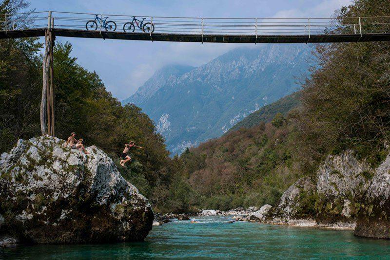 Trans Slovenia 1 jumping in Soca river