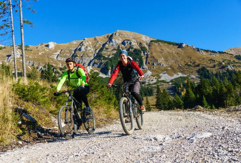 two people biking trans slovenia bike tour