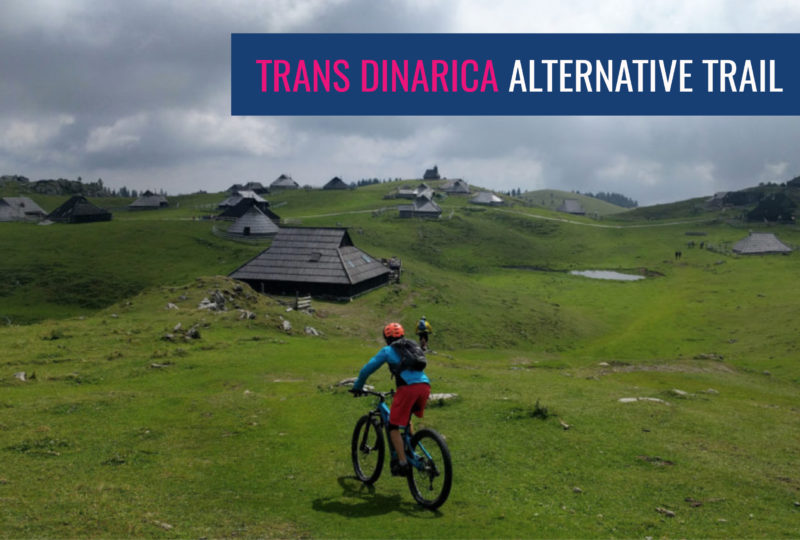 Riding a bike on velika planina as part of trans slovenia and trans dinarica bike tour