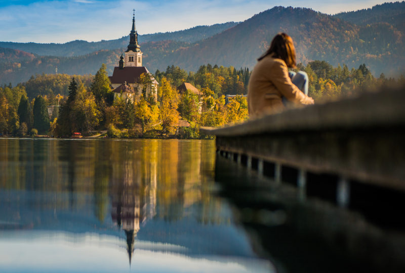 bled island and girl sitting