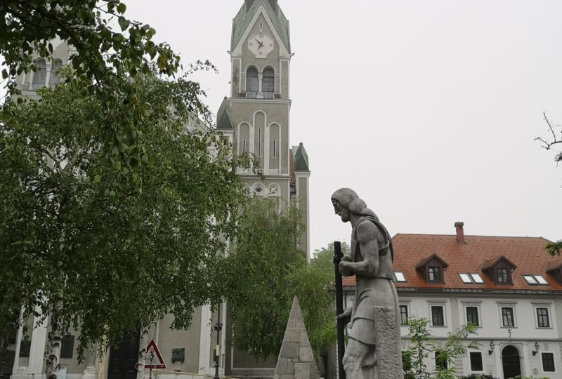 Bridge statue and church in ljubljana