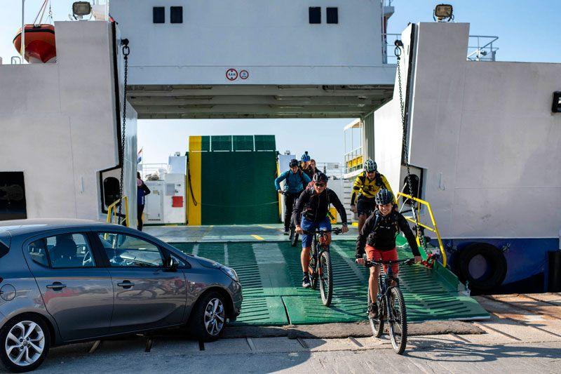 People biking Croatian islands Krk and Vis