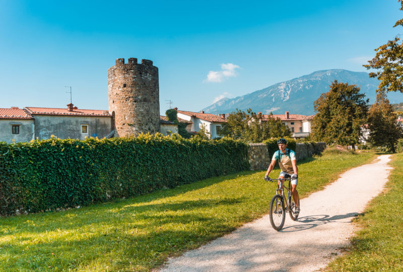 cyclist near castle ajdovscina