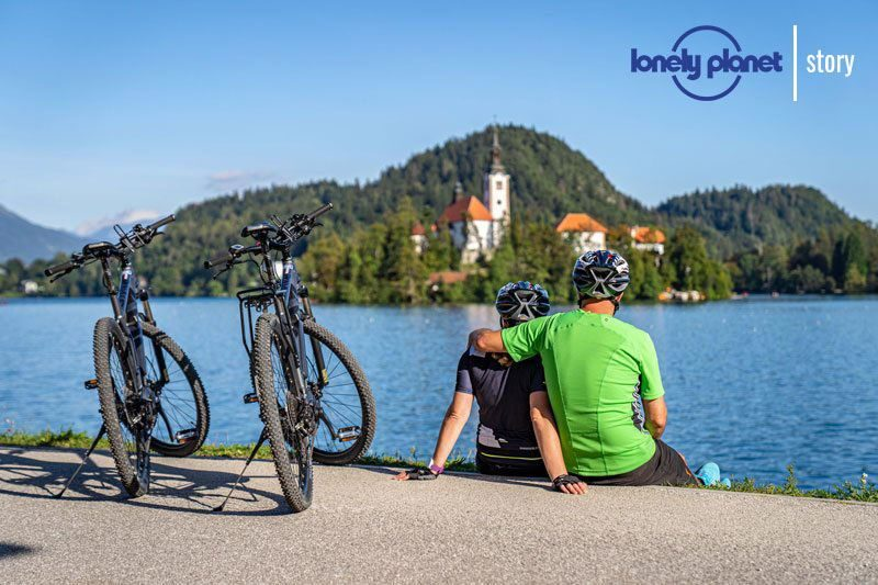 Bike Slovenia Green Bled cycling view of church Lonely Planet